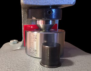 "Using the improved Stainless Steel Starter Cone and the ""Stabilizing"" Reduction Die under a Ring Sizing Machine"